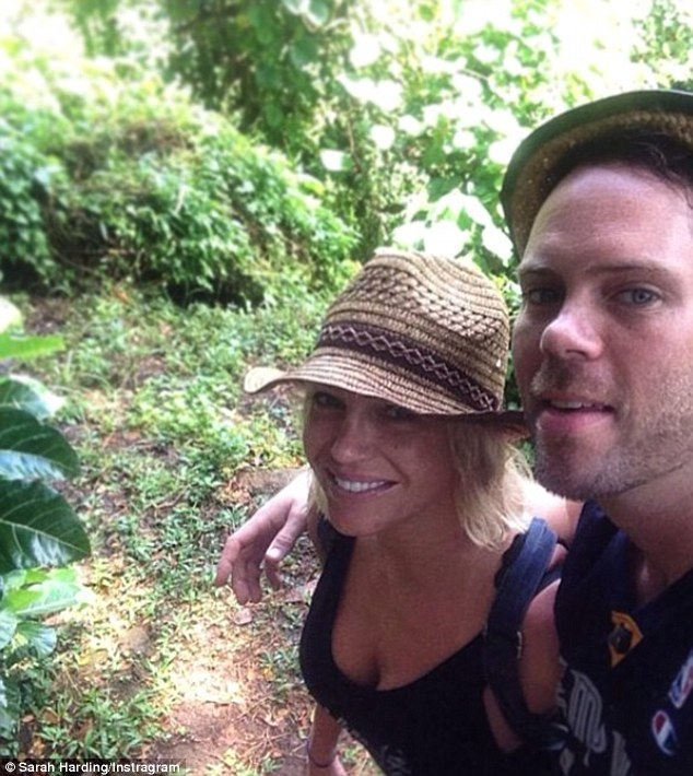 Partner in crime: Sarah was on the blissful holiday with her long term DJ beau