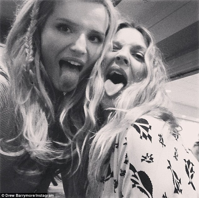 Tongues out: Drew Instagrammed this image on Monday, writing, 'With my girl @bellathorne at the @blended press junket !! #girlshavingfun #blended #loveher'