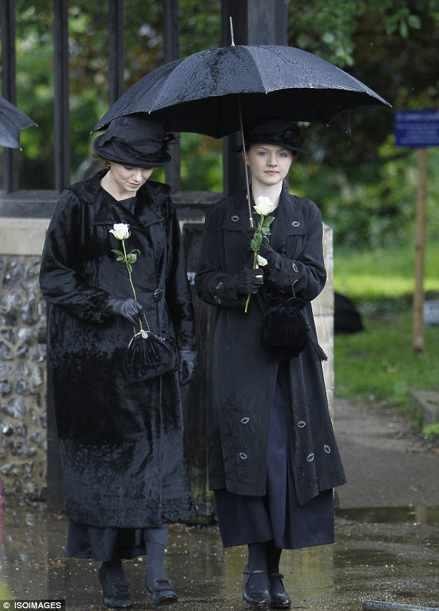 Sister act: Kara Tointon films her first scenes in Mr Selfridge at the funeral of their mother from influenza with co-star Alana Boden (right) - who plays third Selfridge sister Beatrice