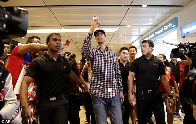 Snap shot: Ferdinand takes photographs after arriving in Singapore