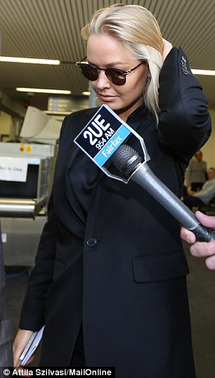 Fidgeting: The blonde beauty ran her hands through her hair as she made her way out of the courtroom