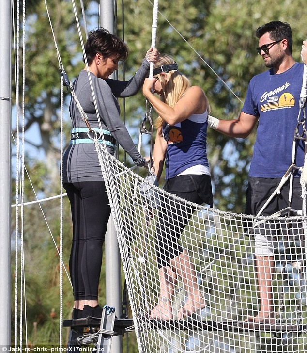 Safety first: The trapeze professionals tended to Jenner's pulley