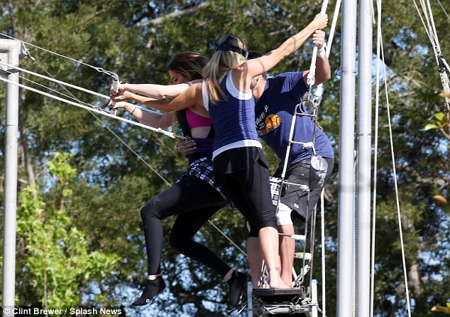 Are you ready!? The duo clung to the Kardashian as her feet dangled in the air