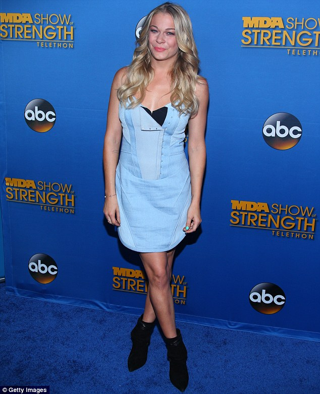 Showing support: LeAnn Rimes lent her support to the event and arrived in a short, sleeveless blue dress