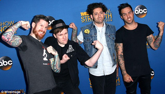 Show of strength: Fall Out Boy members Andy Hurley, Patrick Stump, Joe Trohman and Peter Wentz flexed on the carpet