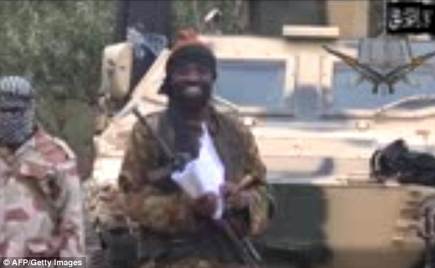 Ruthless: Abubakar Shekau (centre) took over leadership of Boko Haram in 2009 - and the group's campaign then became even more ferocious