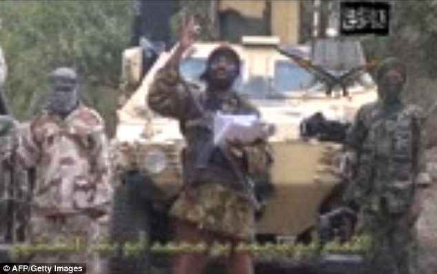 Militant: The leader of Boko Haram, Abubakar Shekau, vows to sell the hundreds of schoolgirls kidnapped in northern Nigeria for as little as £7 during a video message