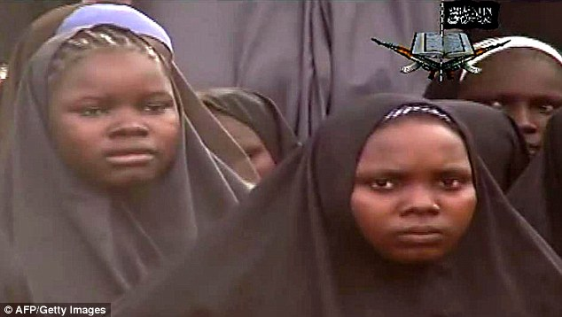 The girls recite Islamic prayers during the clip as they sit in a group in a wooded area