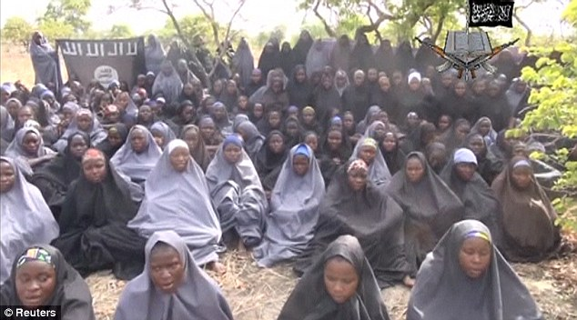 Captured: This image is taken from a video released by the Nigerian terror group Boko Haram reportedly showing some of the girls who were kidnapped from their school last month