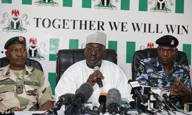 High level: Brig. Gen. Chris Olukolade, Nigeria's top military spokesman, left, Director General, National Orientation Agency, Mike Omeri, centre and Frank Mba, National police spokesman, right, attend a press conference on the abducted schoolgirls
