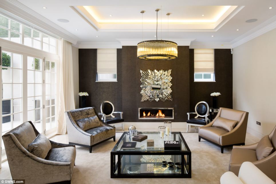 Lounge: This sitting room looks out onto the house's sprawling garden, which backs onto the Highgate Golf Course, should a new owner fancy a round