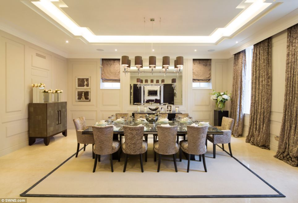 Time for tea: This opulent dining room will easily seat 10 for dinner, while the house's garage can hold four cars
