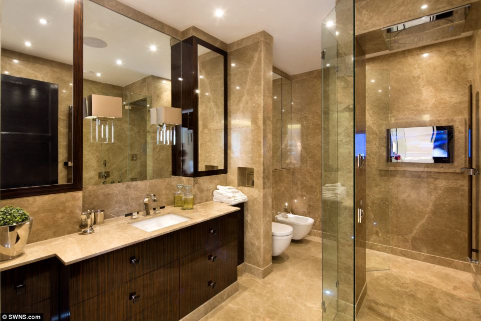 All mod cons: For those who can't bear to miss out on their favourite shows, this bathroom also has a television screen attached to the wall