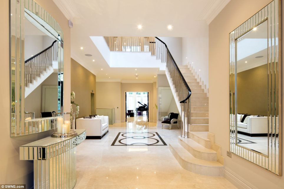 Reflections: This mirrored entrance hall and multi-storey atrium makes for an impressive sight upon entering the mansion through the large double oak doors