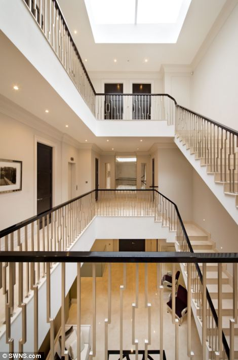 A winding staircase connects the bedrooms of the sprawling property