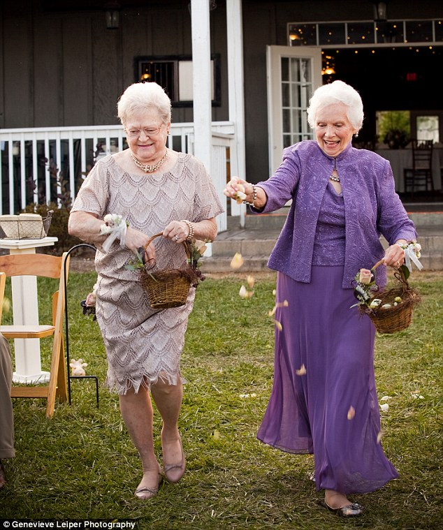 Age is just a number: A growing trend is seeing couples including their grandmothers on their wedding day. Pictured: Annie Rohrmeier (left) and Joyce Arthur-Gunter (right) as flower girls in their grandkids' wedding