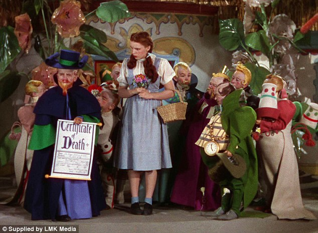 Iconic: Mickey Carroll (to Judy Garland's left hand in the green with pocket watch) appears in the 1939 movie The Wizard of Oz