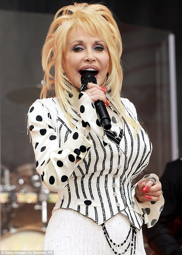 No secret tattoos: Dolly says she only has a few small inkings for her husband