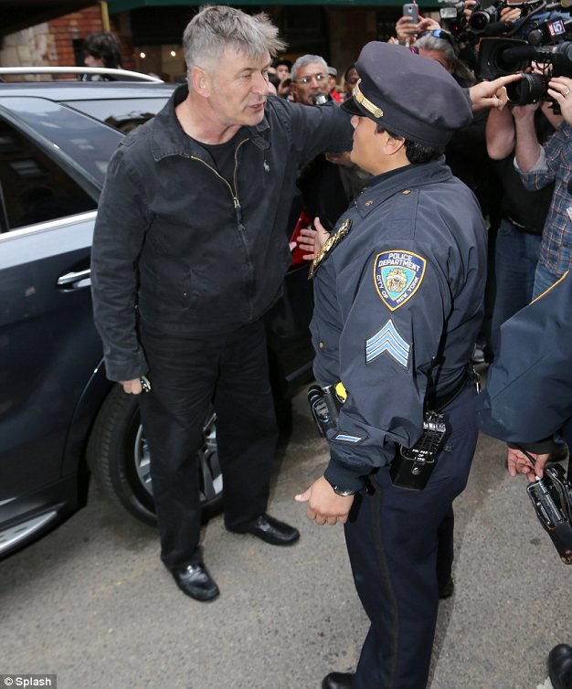 Angry: Tuesday isn't the first time Baldwin has gotten belligerent with police. In November he was animated as they helped him to control the scene as he tried to pack up his car in New York