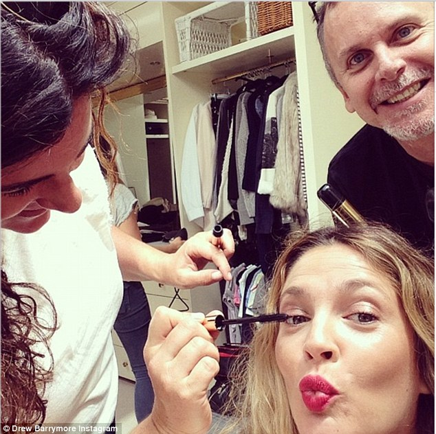 Getting dolled up: The Wedding Singer star Instagrammed this image, captioning it, 'Getting ready for the press tour for @blended! Wearing @flowerbeauty rosey garden lipstick to give me a jump start ! #roseylipsrule'