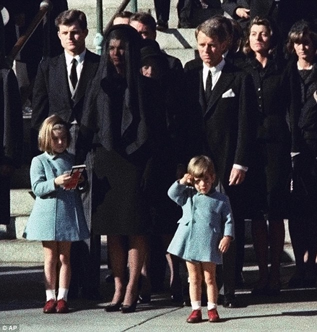 Shaken faith: Jackie, pictured with her young children at JFK's funeral in November 1963, shares her heartbreak with Leonard, admitting that she had become 'bitter against God'