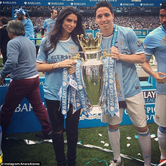 Delighted: Atanes and Nasri pose with the Premier League title after City's win against West Ham
