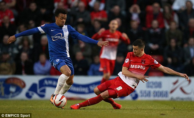 Hard fought: Lloyd James goes in for a tackle on Peterborough's Nick Ajose
