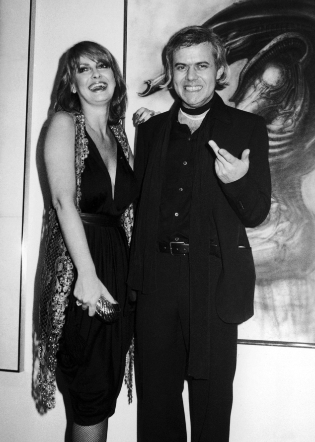 Giger, right, with model Anneka Vasta at the opening of an exhibition in New York