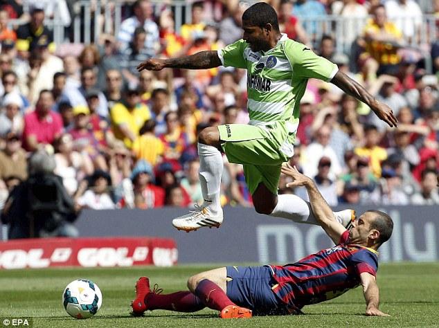 Hard man: Barcelona's enforcer Javier Mascherano (bottom) has added extra strings to his bow