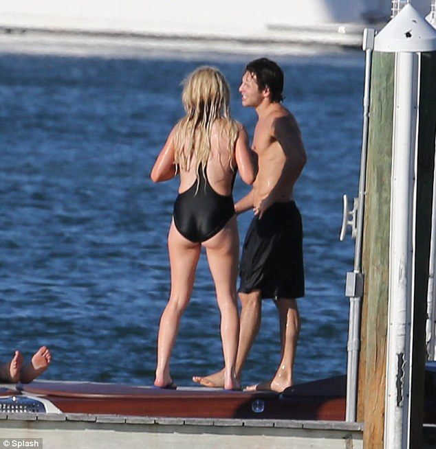 Living the life: Ellie was taking it easy in Miami with Sam's help
