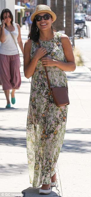 Seasonal style: Rosario opted for a breezy floral print maxi-dress, conventional white flats and a straw hat for her latest outing in Southern California