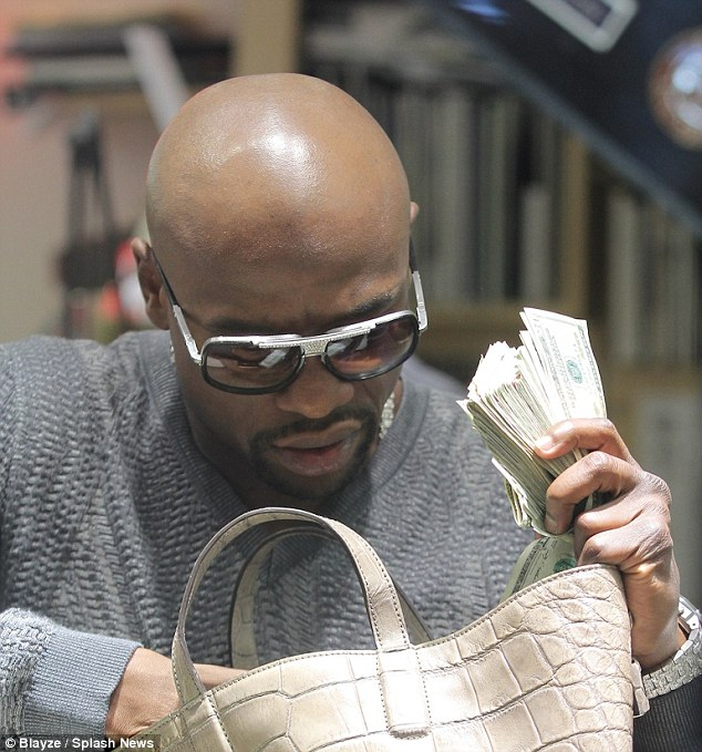 Cash deposit: Mayweather had no scruples about counting his cash when spotted in a jewellery store