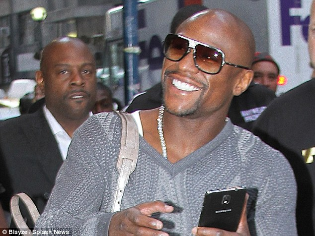 Lap of luxury: Floyd Mayweather is all smiles as he embarks on a potential shopping spree in New York
