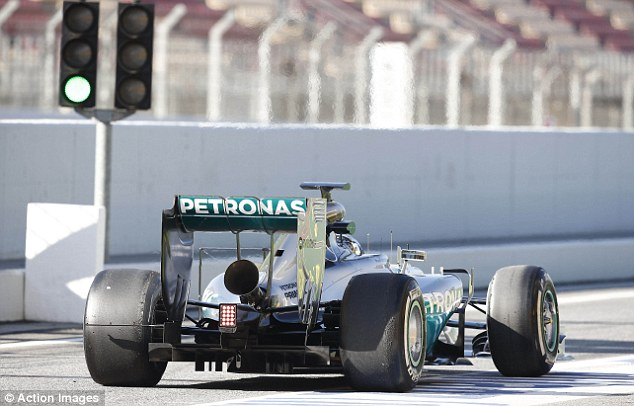 On track: Rosberg, who now trails Lewis Hamilton in the world championship, exits the pits on Wednesday