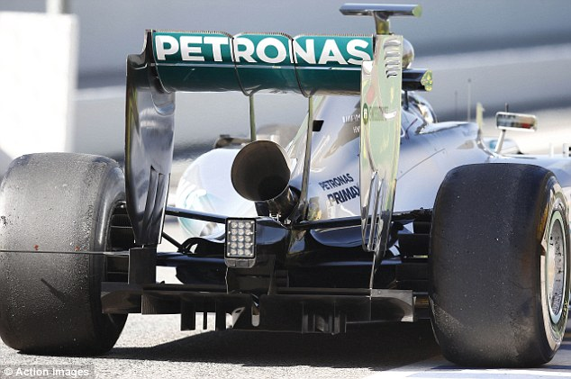Picture that: The tail pipe on the back of Nico Rosberg's Mercedes has been widened to improve the noise
