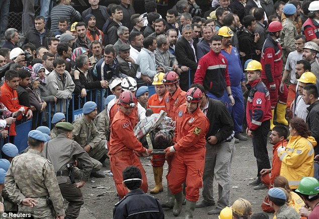 Rescuers carry a miner who sustained injuries to an ambulance. The explosion, which triggered a fire, occurred shortly after 3 pm - midday GMT - on Tuesday and the death toll is feared to be rising. Local hospitals have been overwhelmed by the scale of the disaster