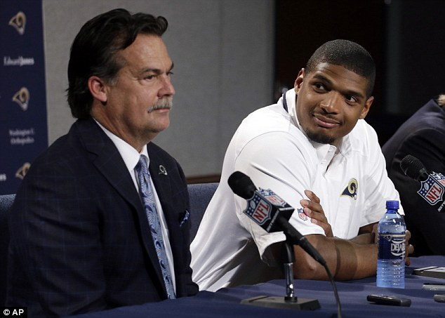 An honor: Sam said he was blessed to be in the NFL. Pictured above at the Tuesday press  conference with Rams coach Jeff Fisher