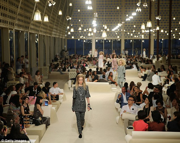 All aboard! A model walks the runway at the Chanel Cruise Collection 2014/2015 at The Island in Dubai, United Arab Emirates