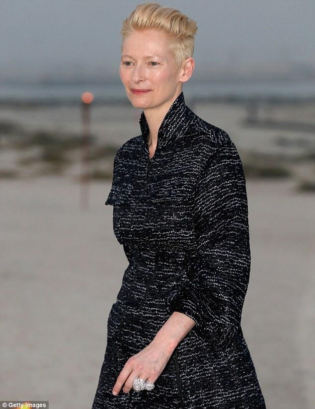 Cutting edge of fashion: Oscar-winning actress Tilda Swinton showed off her trademark buzz cut at the fashion event wearing a monochrome jacket