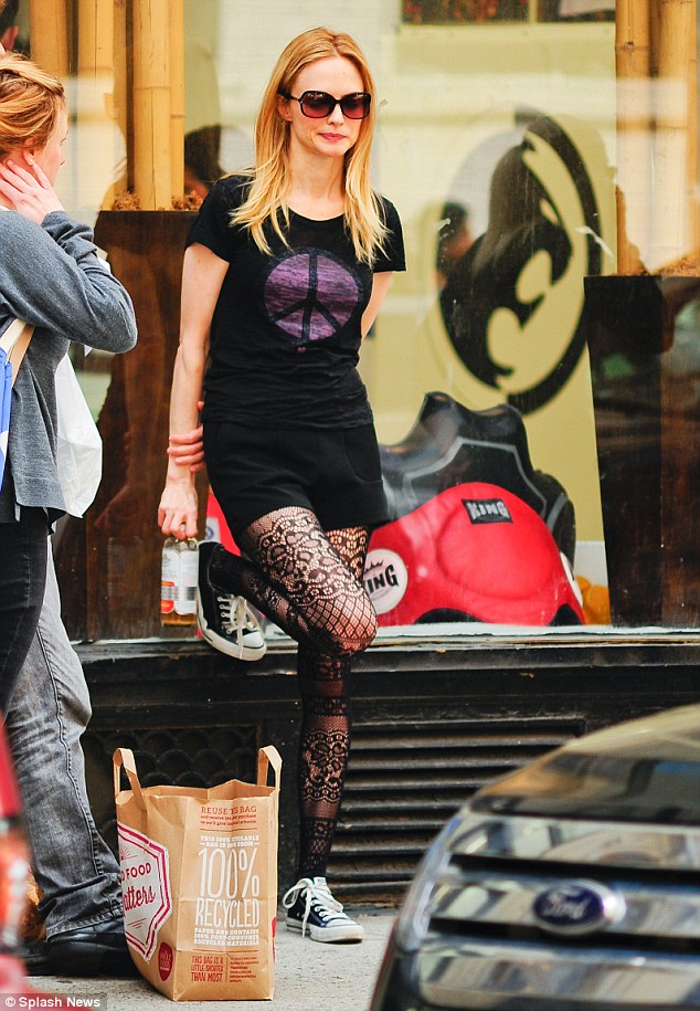 Peace loving: The 44-year-old actress matched her jazzy leggings with black shorts and a peace sign T-shirt