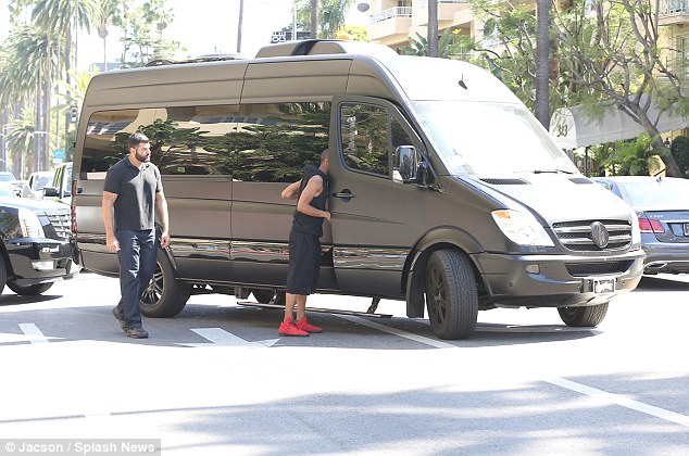 On his way out: On Tuesday the Believe star was spotted getting into his black SUV outside the Four Seasons Hotel in Beverly Hills
