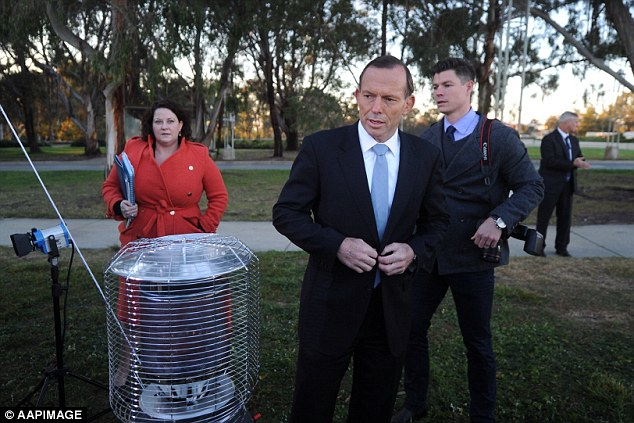 Mr Abbott, pictured in Canberra on Wednesday, was left stunned for a moment on TV when Ms Ward slammed his budget