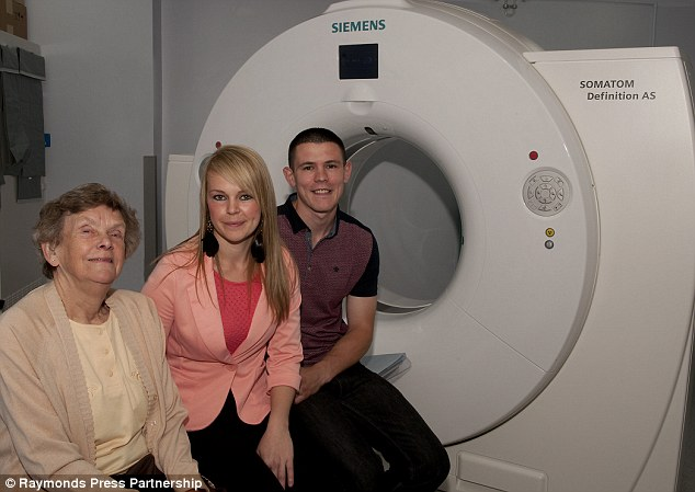 Act of kindness: James Redgate left £1.1million to a Notttingham Hospital Trust. His money bought two new state-of-the-art CT  scanners. Pictured, his sister Joan (left) and other relatives in front of one of the scanners