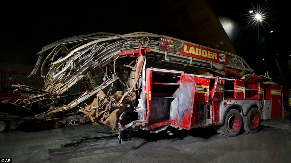 Cut in half: The remnant of a firetruck that was damaged in the September 11 attacks is one of the biggest displays at the memorial museum