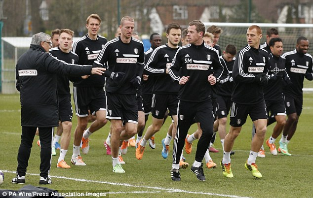 Running order: Fulham, seen here earlier in the season, have been told to return to training this week