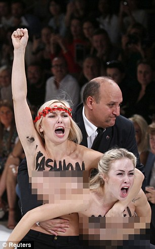 Anti-fashion: Two FEMEN activists stormed the Nina Ricci show in Paris last September