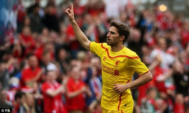Return: Fabio Borini celebrates scoring Liverpool's second goal of the game