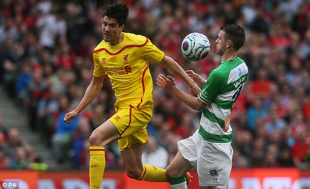 Defensive: Ciaran Kilduff (right) chests the ball to keep it away from Martin Kelly