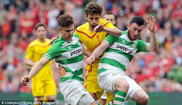Room for a small one: Borini attempts to squeeze past Luke Byrne and Ryan Brennan