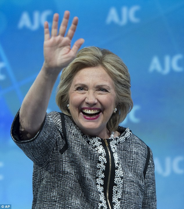 Irony: The former Secretary of State  waves to the audience at the conclusion of her address today to the American Jewish Committee (AJC) Global Forum closing plenary in Washington. Family members say her mother often made anti-Semitic remarks